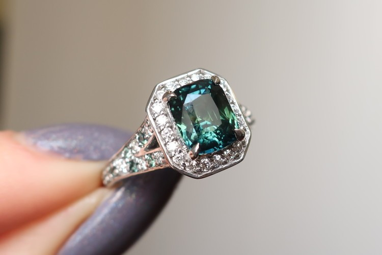 cushion cut teal sapphire engagement ring with diamonds