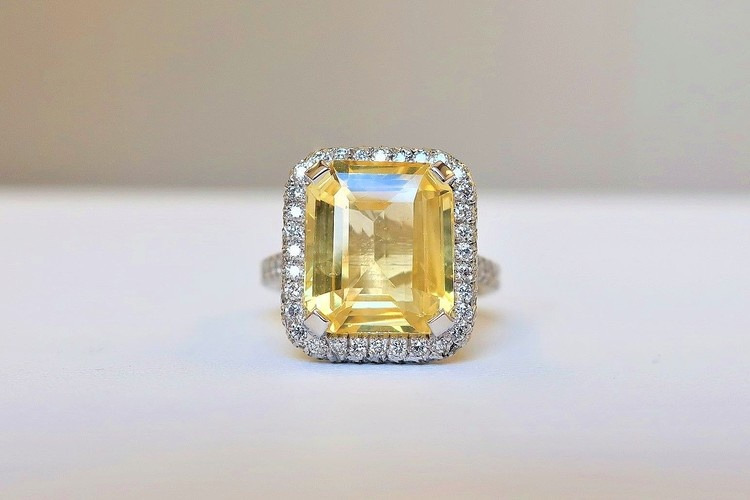 emerald cut yellow sapphire engagement ring with custom halo