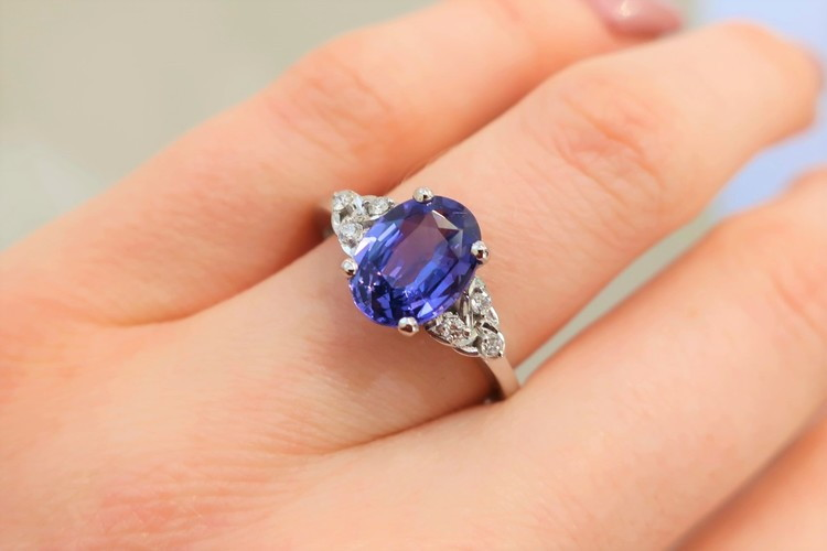 oval blue purple sapphire engagement ring with diamonds