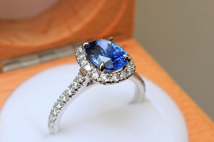 oval blue sapphire engagement ring with halo
