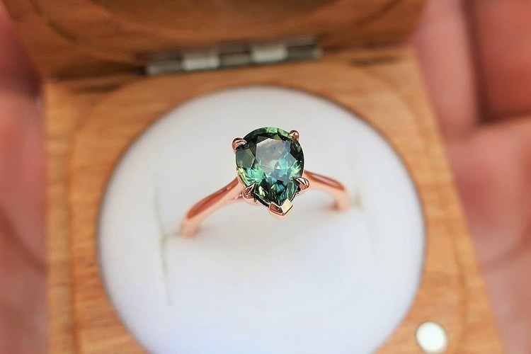 pear shaped teal sapphire engagement ring with trellis