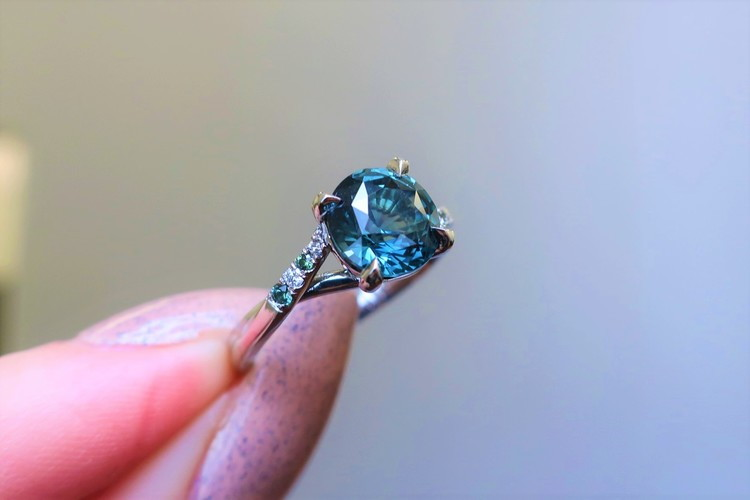 round teal sapphire engagement ring