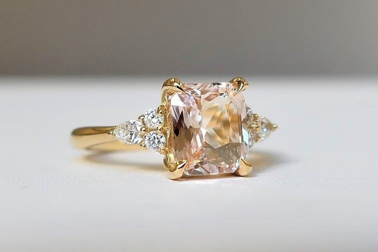 radiant cut peach sapphire engagement ring cluster