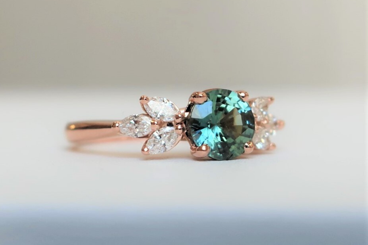 round teal sapphire engagement ring floral cluster