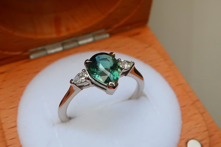pear shaped teal sapphire engagement ring three stone