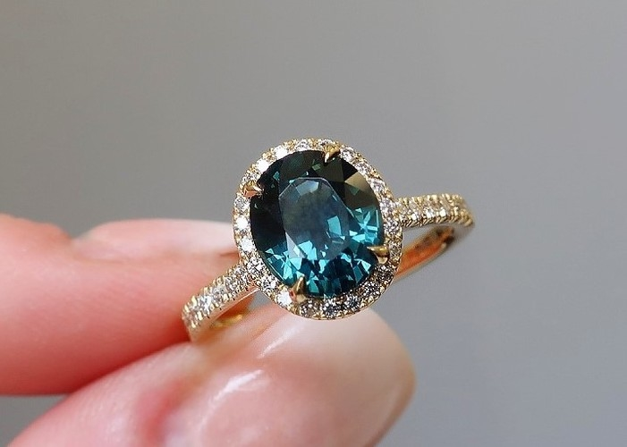 oval teal sapphire engagement ring halo