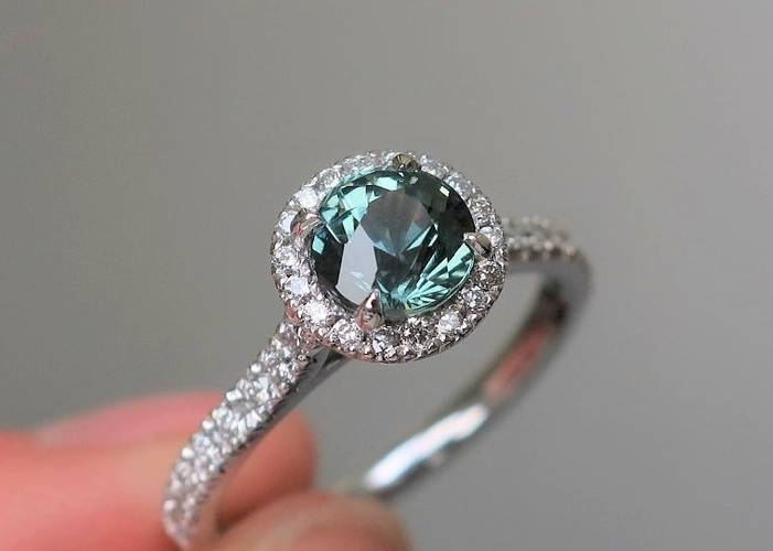 round teal sapphire engagement ring halo